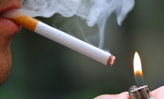 trồng răng Implant có hút thuốc được không